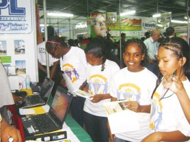Checking bills? Something at this Guyana Power and Light booth seems to have caught the interest of these lasses from President's College, who were among a group from the school that toured the exhibits at GuyExpo 2009 at the Sophia Exhibition Centre yesterday. (Gaulbert Sutherland photo)