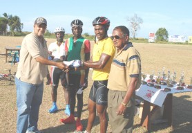 Junior Niles receives his prize after finishing first in the under-50 veterans' race.