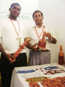 Ashraf Mohammed Ally (right) and his nephew Colin Nero at their booth at GuyExpo 2009 yesterday.