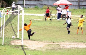 Georgetown Association's Charmaine Warde strikes her team's winning goal against Bartica Sunday last (Orlando Charles photo)
