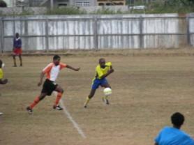 Telson Mc Kinnon attempts a shot at goal.