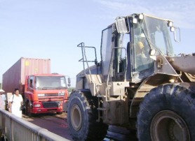 Bosai to the rescue, the front-end loader towing the truck off the middle span of the bridge.