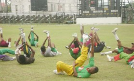The Guyana players go through their paces at the GCC ground yesterday. The squad is currently preparing for the WICB President's Cup tournament.