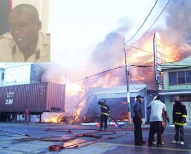 Firemen battling last Friday's Regent Street inferno. (Inset is Fire Chief Marlon Gentle)