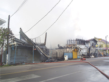 The destroyed buildings: At left is Household Plus while farther down is the Wireless Connections building. The building partially shown at far right is the Bounty supermarket. (Gaulbert Sutherland photo)