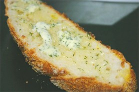 Warm, crusty bread with herbed butter (Photo by Cynthia Nelson)