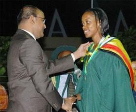 President Bharrat Jagdeo presenting the President's award to Loria-Mae Angela Heywood. (GINA photo)