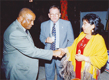 Minister Fox greets former US Ambassador to Guyana Roland Bullen while former UK High Commissioner Stephen Hiscock looks on.
