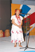 Minister Fox performing a traditional Amerindian song at the launch of Carifesta X in Guyana last year.