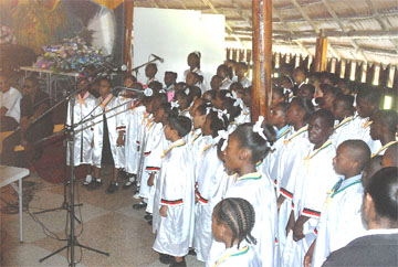 The National Schools' Choir pays tribute to Minister Fox  in national songs.
