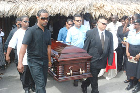 The sons of the late minister (left) and her brothers (right) bearing her casket out of the Umana Yana yesterday.  Dr Desrey Fox was cremated at the Ruimzigt Crematorium.  (Jules Gibson photo)