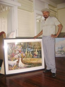 Jorge Bowenforbes stands near one of his works of art