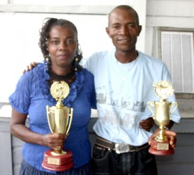 Precious Pearl and Young Bill Rogers proudly display trophies which they won after placing first and second respectively with entries they submitted to the Rajkumari Singh category of the Guyana Annual.