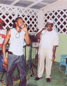 Supercat is given competition by another singer during a performance on the East Coast of Demerara recently.