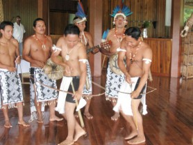 Male members of the Surama Makushi Culture Band dancing at an event. (Photo courtesy of Dr Raquel Thomas)