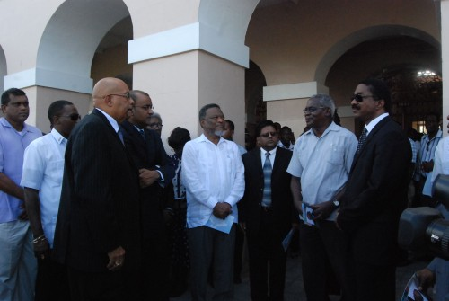 From left: Dr Richard Van West Charles, President Bharrat Jagdeo, Prime Minister Samuel Hinds, Finance Minister Dr Ashni Singh, Transport Minister Robeson Benn and PNCR MP Basil Williams exchange greetings at Parliament Buildings today as they wait for the viewing of Winston Murray's body as it lay in state from 10:00 hrs to 12:30 hrs. (Photo by Jules Gibson)