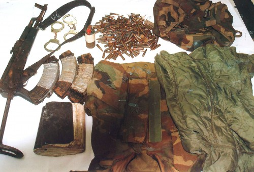 The arms, ammo and other items found by police. (Police photo)
