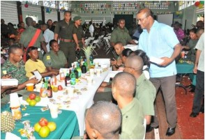 President Bharrat Jagdeo serving meals to officers of the Guyana Defence Force (GINA photo)