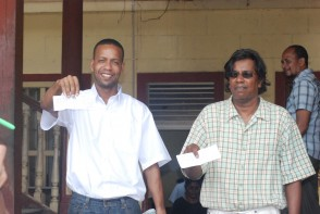 Mark Benschop (left) and Freddie Kissoon with their bail receipts