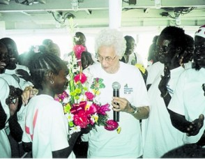 """Dame Olga """"Aunty Olga"""" Lopes-Seale and the children on board the MV Harbour Master at one of her annual Christmas parties."""