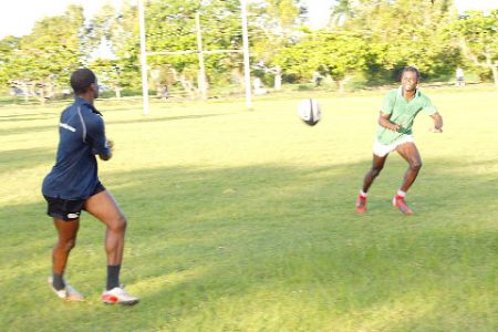 Memebers of the nationa rugby Sevens Squad work on their passing yesterday at the National park in preparation for the International Rugby Board Sevens World Series on February 12 and 13 in Las Vegas, United States (Orlando Charles Photo)