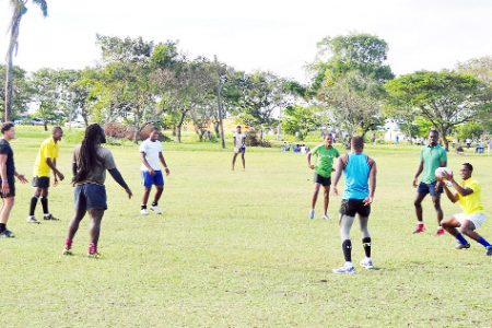 Members of the national rugby Sevens team go through a passing exercise yesterday at the National Park as they prepare for the IRB Sevens World Series on February 12 and 13.