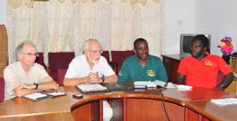 GRFU president Kit Nascimento (second from left) addresses the media during a GRFU press conference held yesterday at the Olympic House, High Street. Others in photo from left are Mike McCormack, Robin Roberts and Theodore Henry. (Orlando Charles photo)