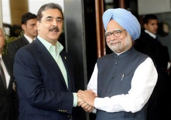 akistan's Prime Minister Yusuf Raza Gilani (L) shakes hands with his Indian counterpart Manmohan Singh before the start of the ICC Cricket World Cup semi-final match between India and Pakistan in Mohali March 30, 2011.  Credit: Reuters/Raveendran/Pool
