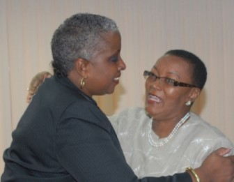 Minister of Foreign Affairs Maxine McClean (right) yesterday welcoming Jamaica's High Commissioner to Barbados Sharon Saunders. (Barbados Nation photo)