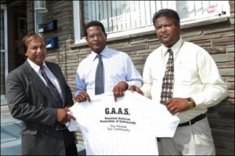 From left, Treasurer Leakh Bhoge, President John Mootooveren and Vice President Bhisham Nandalall pose for a portrait in front of the Guyanese American Association of Schenectady building Monday at 1001 State St. (Daily Gazette.Com photo)