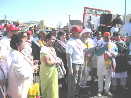 Officials performing prayers at the start of the Phagwah parade in Richmond Hill, New York on Sunday afternoon. Thousands of Guyanese Americans and celebrants from other nations turned up to play phagwah. (Photo courtesy of Vishnu Bisram)