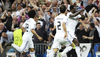 Emmanuel Adebayor (right) maintained his superb scoring record against Tottenham to lead Real Madrid to victory.