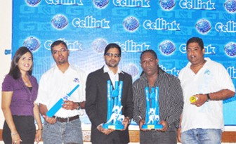 GT&T CEO Yog Mahadeo (third from left) and representative of Hits and Jams Entertainment Kerwin Bollers display the GT&T 10/10 trophies as other stakeholders look on.