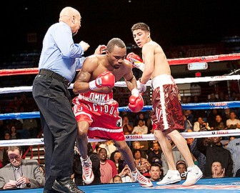 Vivian Harris on his way out in his fight against Jesse Vargas (Fightnews photo)