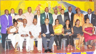 40 Plus Club! Recipients of awards at Friday evening's Pele Football Club 40th anniversary awards ceremony pose for a photo opportunity with Minister of Sport, Dr Frank Anthony and Guyana Football Federation president, Colin Klass. (Orlando Charles photo)