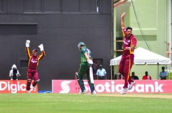 Wicketkeeper Carlton Baugh and Ravi Rampaul celebrate the wicket of Pakistan captain Shahid Afridi. (Orlando Charles photo)