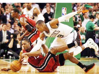 Boston Celtics guard Rajon Rondo chases a loose ball with Miami Heat forward Mike Miller during the second half of Game 3 of their NBA Eastern Conference playoff series in Boston, Massachusetts on Saturday night.