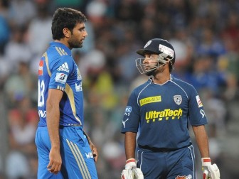 Amit Mishra struck Munaf Patel, left, for four successive boundaries in one over to take Deccan to 135.