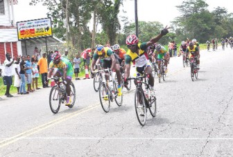 Guyana's Godfrey Pollydore (right) celebrates upon finishing first in the final stage of the Three-stage Road Race ahead of Warren Mc Kay (centre) and Yosimi Pol (left). (Orlando Charles Photo)