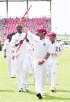 Ravi Rampaul leads the victorious West Indies team off the pitch after their win against Pakistan (Orlando Charles photo)