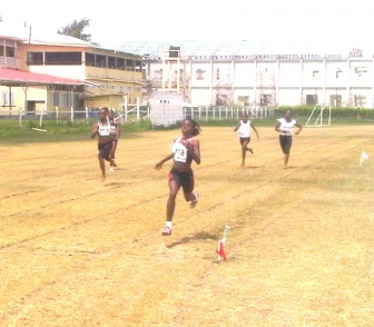 Jevina Sampson romps her way to victory in the girls' Under-15 150 metres event.