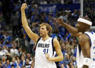 Dallas Mavericks' Dirk Nowitzki (L) of Germany celebrates a basket by a teammate against the Los Angeles Lakers during Game 4 of the NBA Western Conference semi-final basketball playoff in Dallas, Texas on May 8.