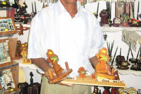 Ramsook with some of his items at the Church View Gift & Flower Shop
