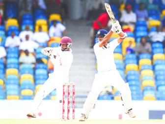 Rahul Dravid who got the benefit of the doubt when Adrian Barath claimed a catch when the batsman was on nine, went on to make his second half century of the match yesterday.