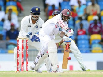 Shivnarine Chanderpaul defends during his partnership with Darren Bravo.