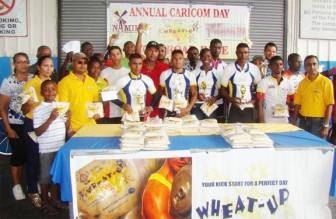 Officials of National Milling Company and Roraima Bikers Club pose with the prize winners following the Wheat Up cycle road race.