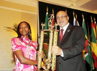 In picture Guyana's Euleeen Josiah-Tanner receives her trophy from president of the Republic of Suriname Desi Bouterse.