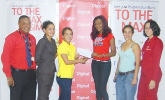 Shonnet Moore (third from right) hands over cheque to female captain Chantelle Fernandes.