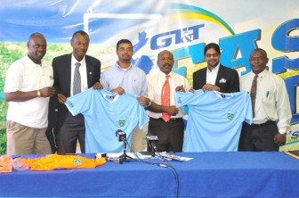Representatives of GT&T, the GRFC and the GFF display the new referees uniforms at the signing ceremony on Thursday.