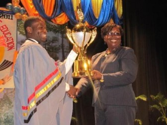 Best Graduating Student, Dellon Parris receives an award from the Region Three Education Officer. (GINA photo)